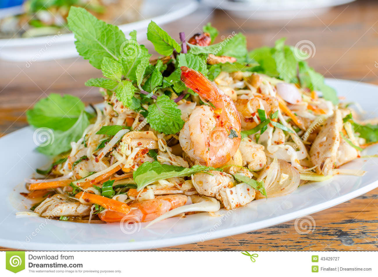 Thai Spicy Salad With Chicken, Shrimp, Fish And Vegetables Stock Photo ...