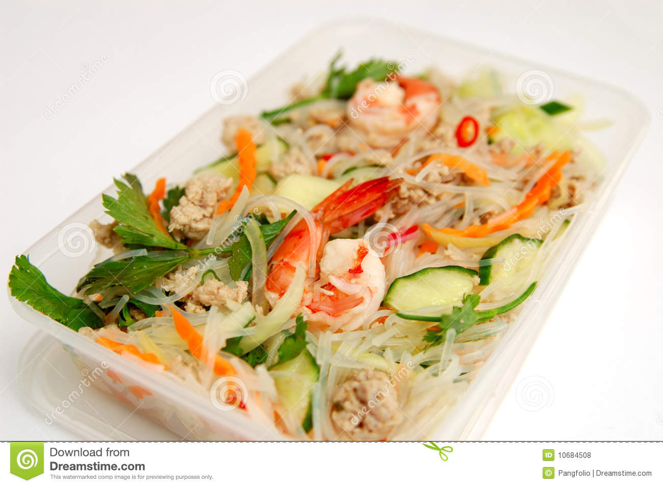 close up of Thai spicy seafood salad in a take away plastic box. A ...