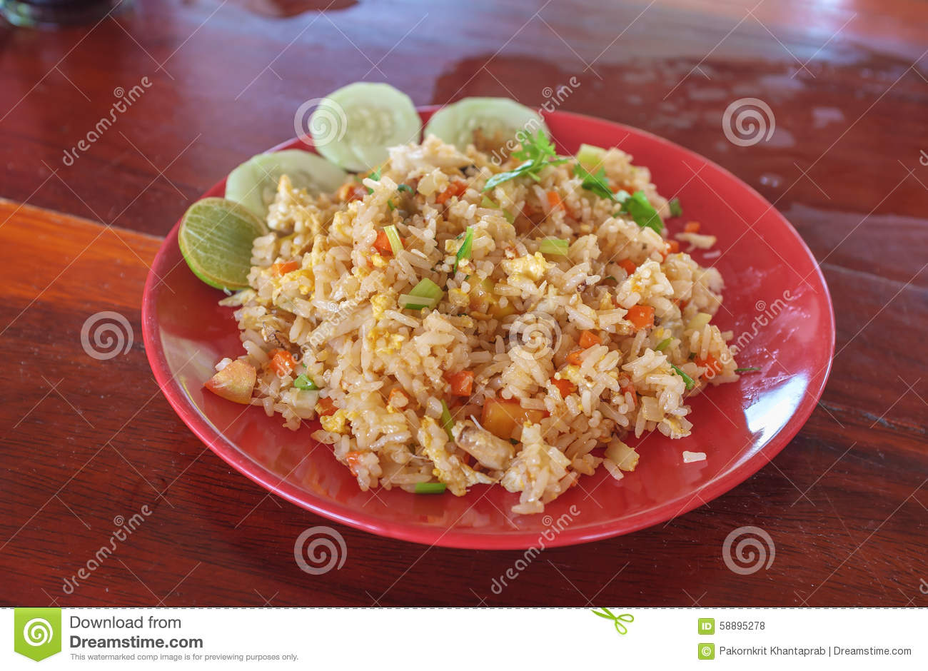 Thai style stir fried rice in red plate.