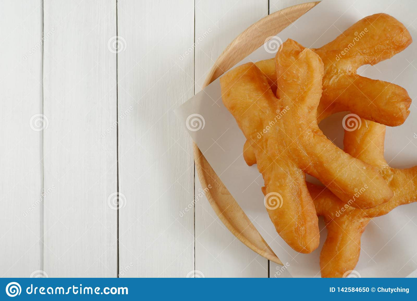 Thai style Chinese crullers in wooden plate.