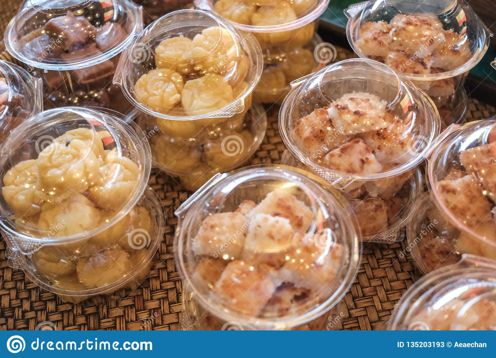 Thai style desserts in plastic boxes