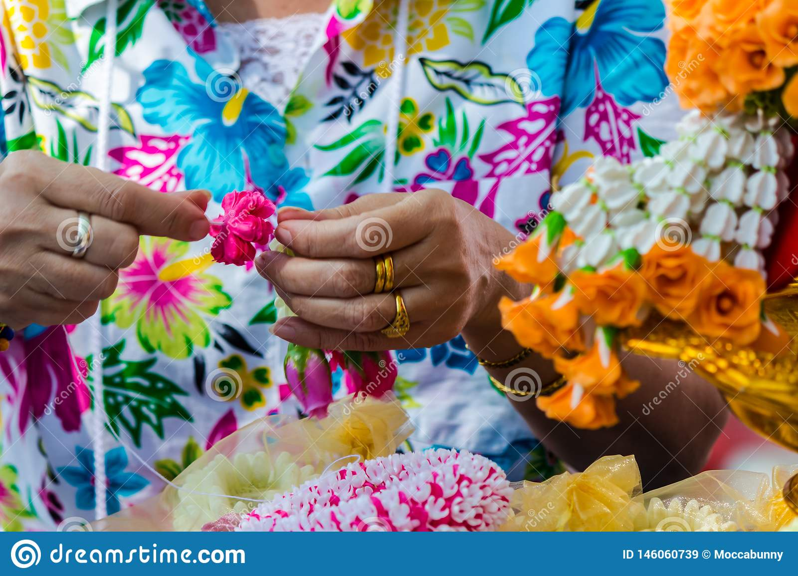 Thai Woman Making A Tradition Thai Flowers Garland Stock Image