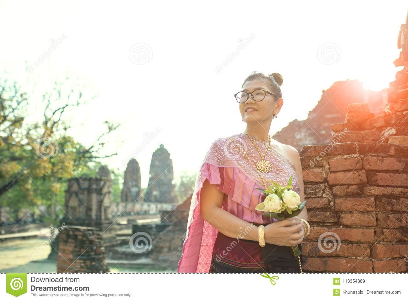 Thai woman toothy smiling face standing with pink lotus flower b thai woman toothy smiling face standing with pink lotus flower b stock image image of floral beauty 113354869 izmirmasajfo