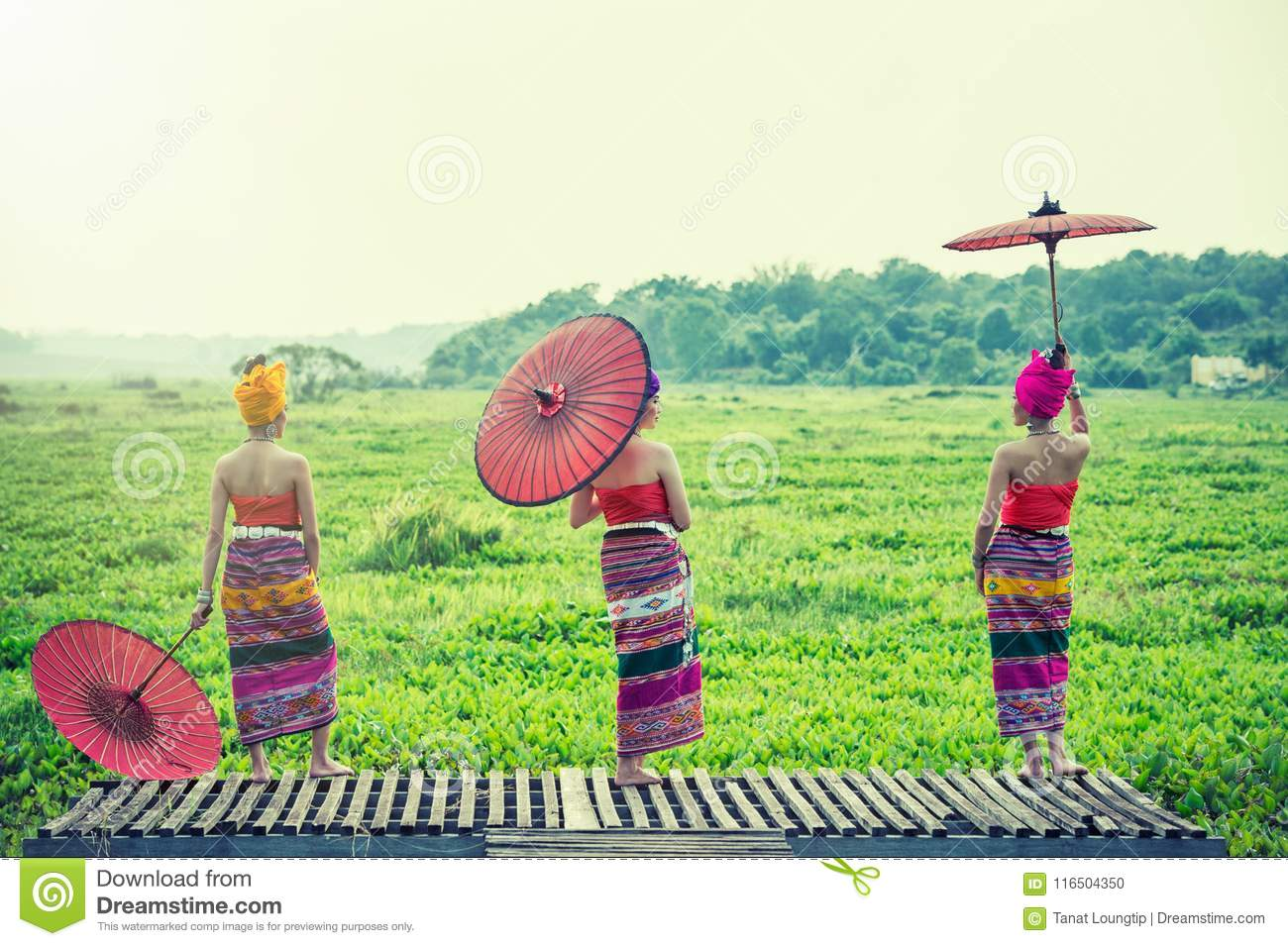 Thai Woman In Traditional Costume with umbrella thai culture st