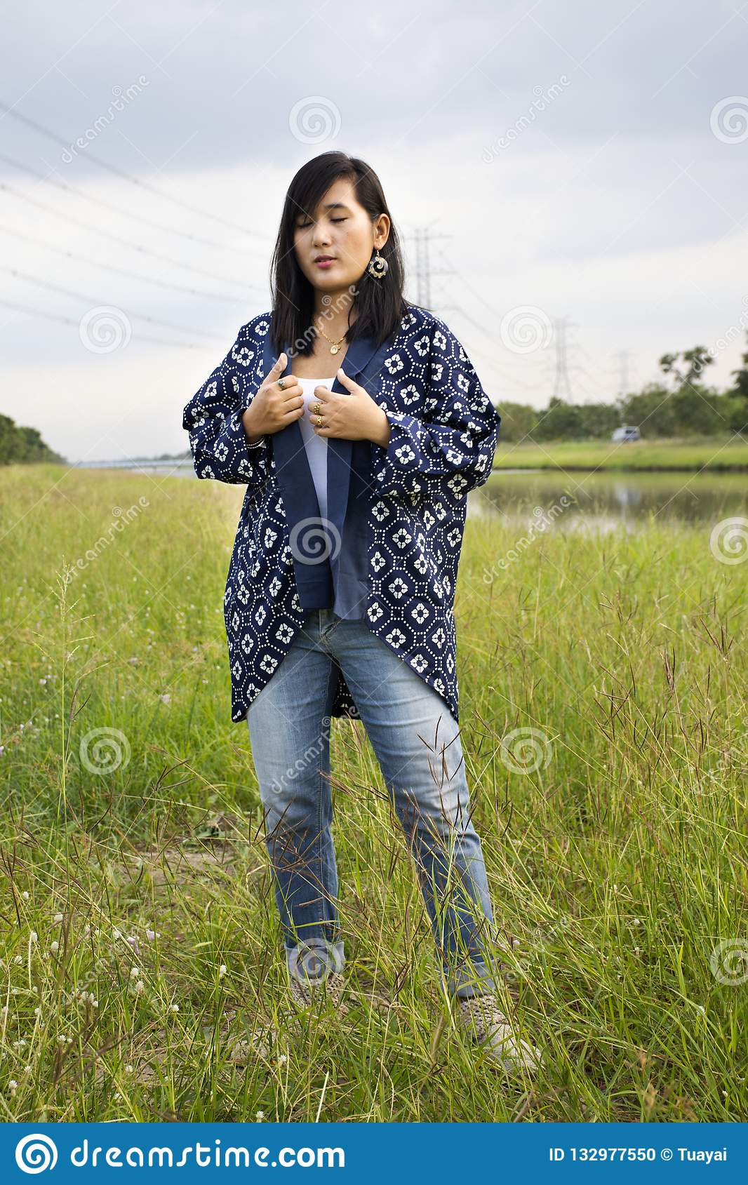 Thai woman wearing fashion indigo clothes posing portrait for take photo at  outdoor