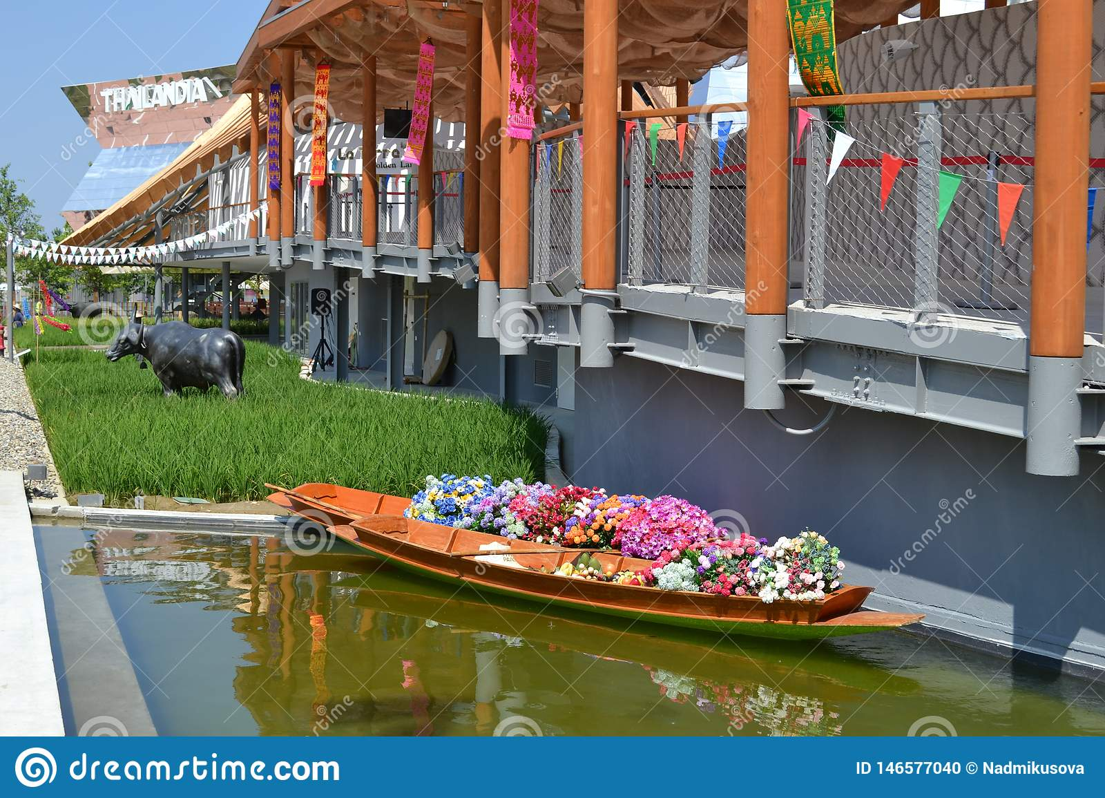 Thai wooden traditional boat for floating market filled up with flowers at the Thailand pavilion of the EXPO Milano 2015.