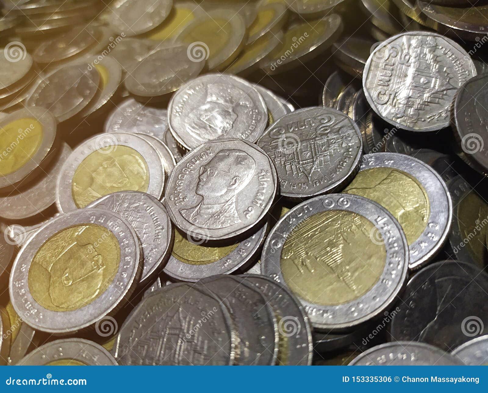Thailändischer Münzenstapelabschluß herauf Hintergrund