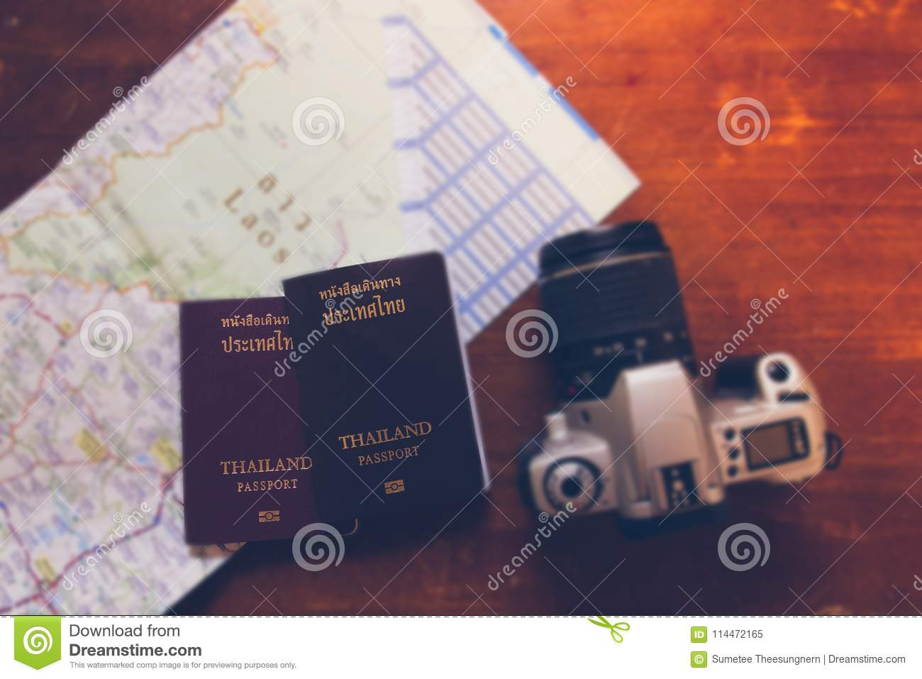 Thailand passport and camera on the map for World travel and travel asia