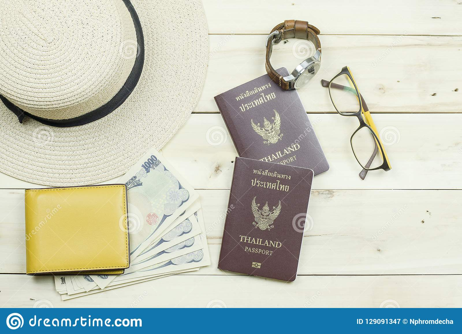 Thailand passport, hat, glasses, watch, yellow wallet and cash.