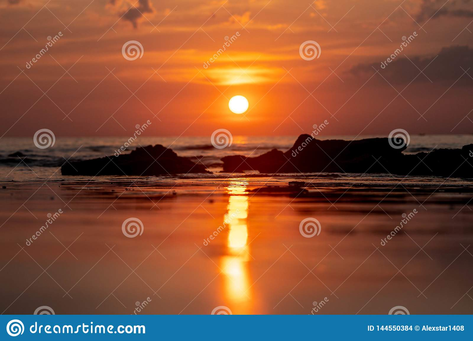 Thailand Sunset reflecting on the beach
