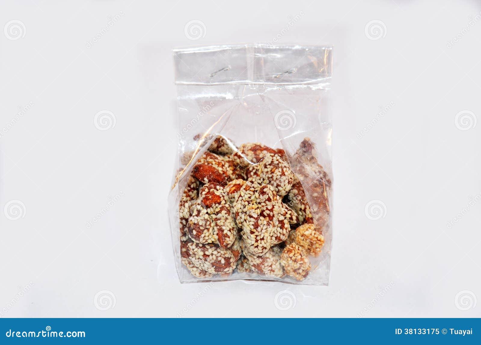 Thaise de onderdompelingssuiker en sesam van de Snackamandel in plastic zak