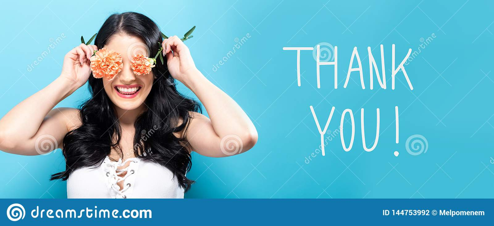 Thank you message with young woman holding carnations