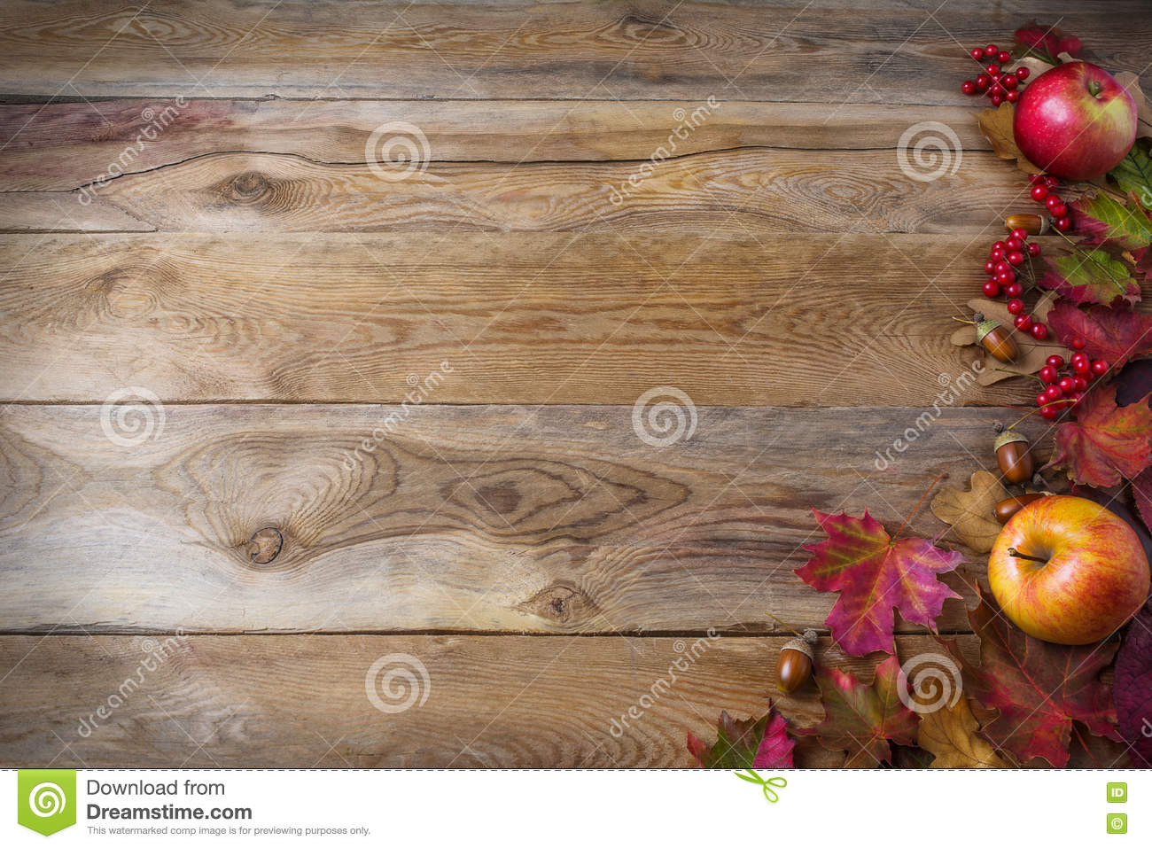 Thanksgiving background with apples, acorns, berries and fall le