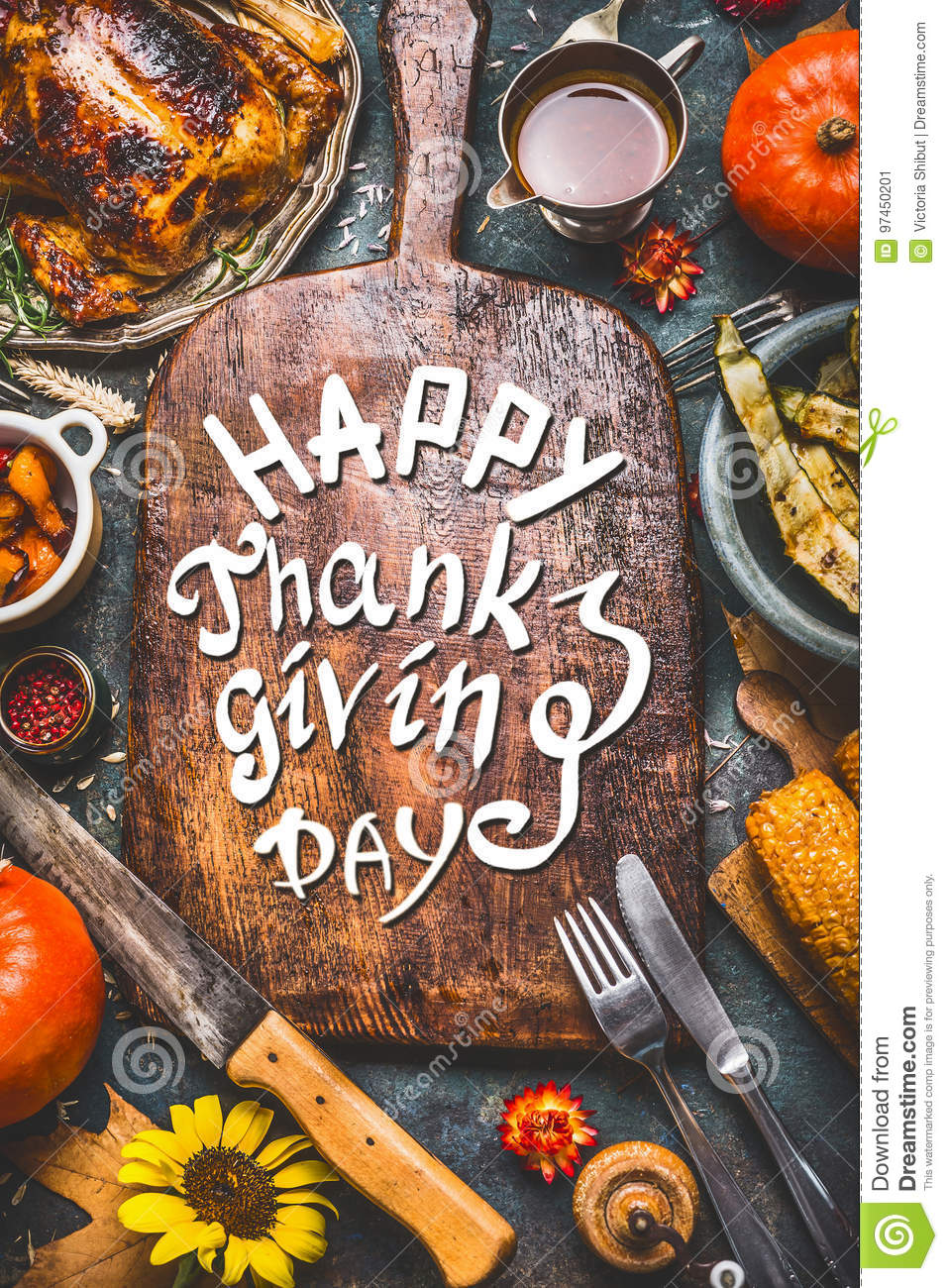Thanksgiving dinner background with turkey ,sauce,grilled vegetables,corn ,cutlery , pumpkin, fall leaves and text Happy Thanksg