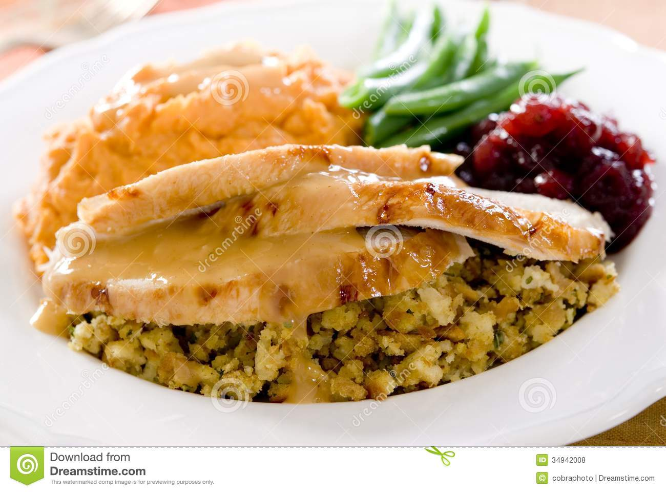 Traditional thanksgiving turkey dinner with cranberry sauce, stuffing ...
