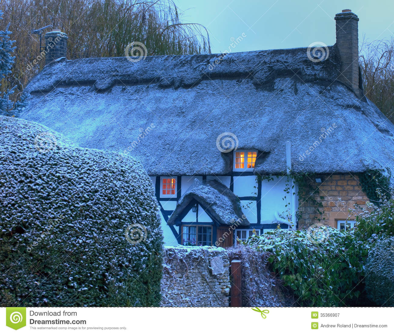 Black and white timber framed thatched cottage in winter mickleton