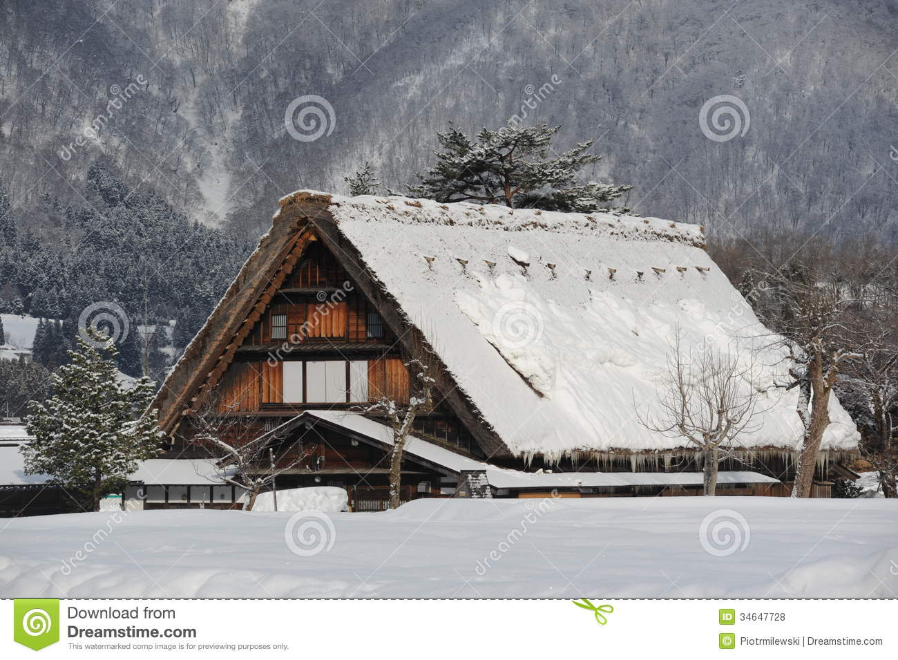 Thatched Roof House Covered In Snow In Winter Royalty Free