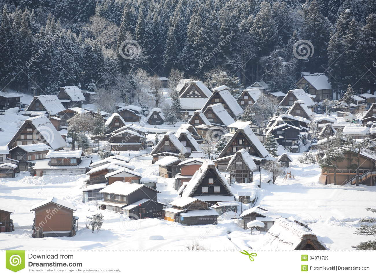 Thatched Roof Houses Covered In Snow Royalty Free Stock