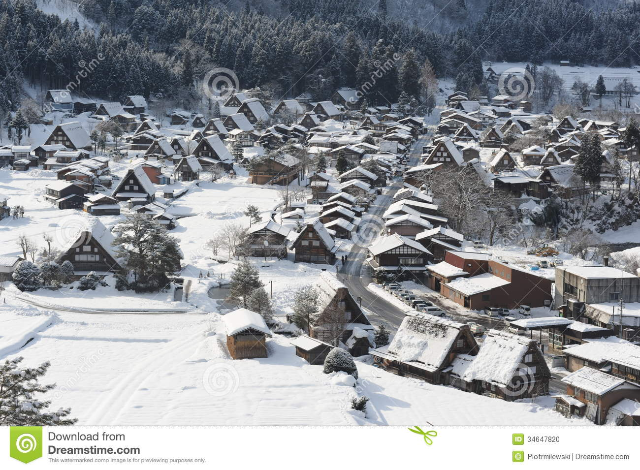 Thatched Roof Houses Covered In Snow In Winter Stock Photo