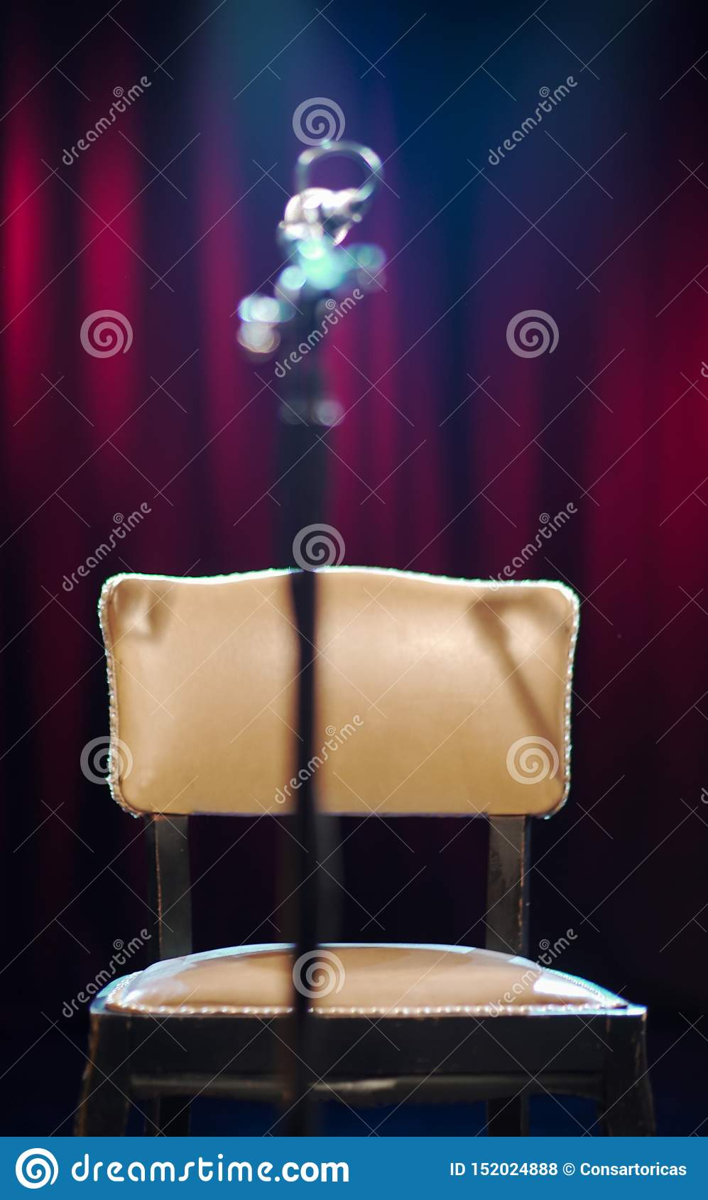 theater chair with a microphone standing