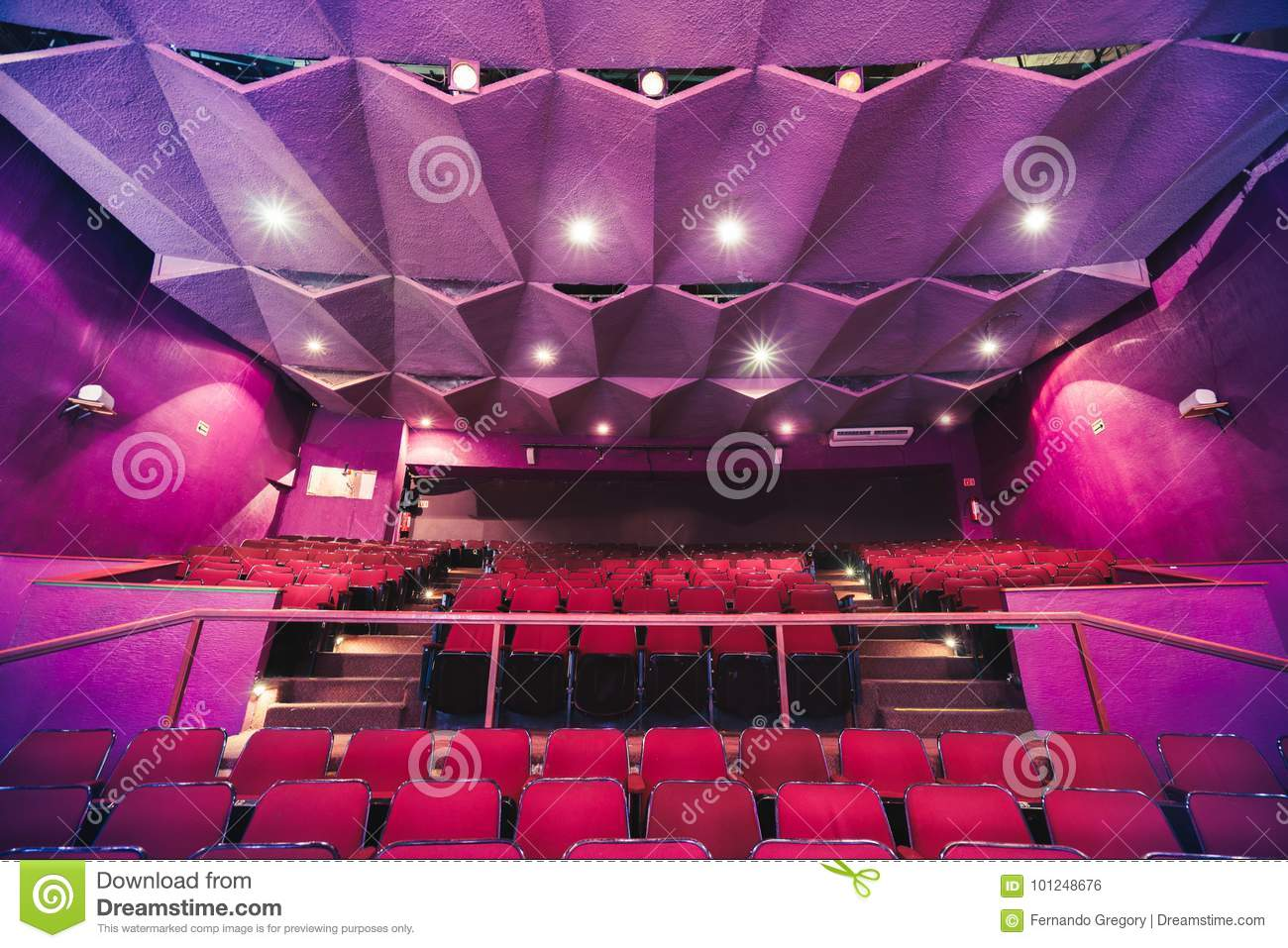 Theater seats with dramatic lighting
