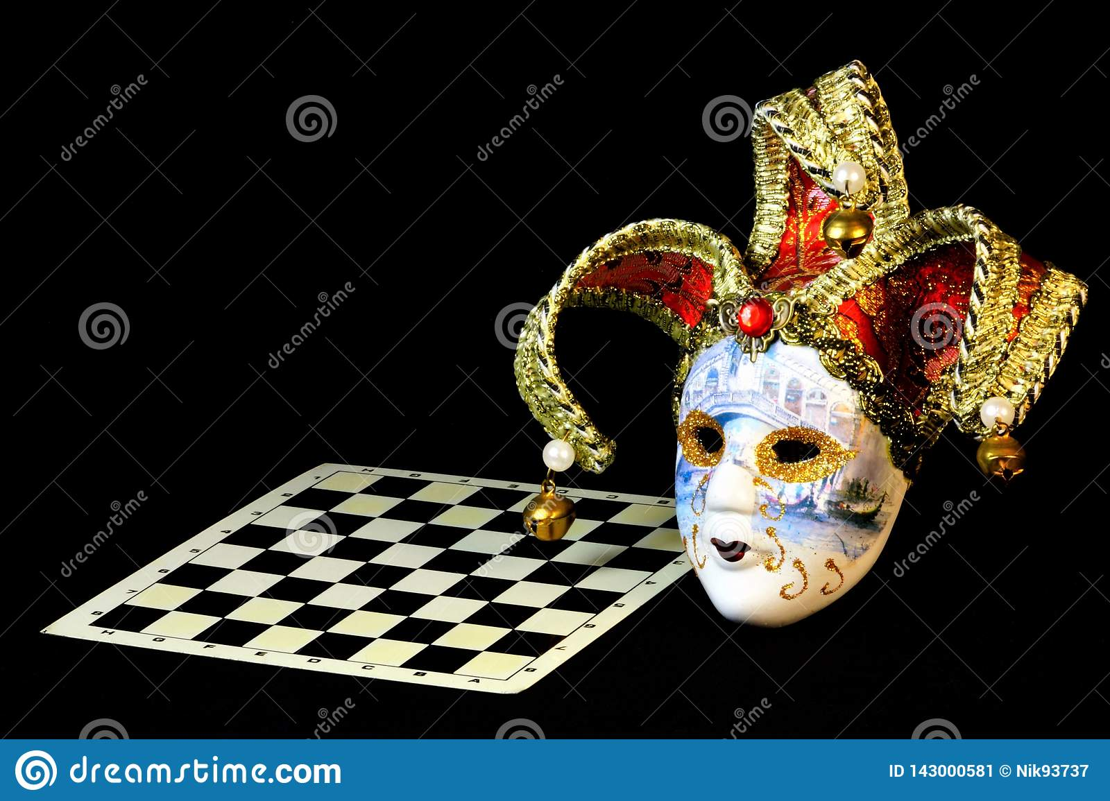 Theatrical carnival mask and chess Board. The mask is a symbol of transformation, change and mystery, real to desired. The aspect