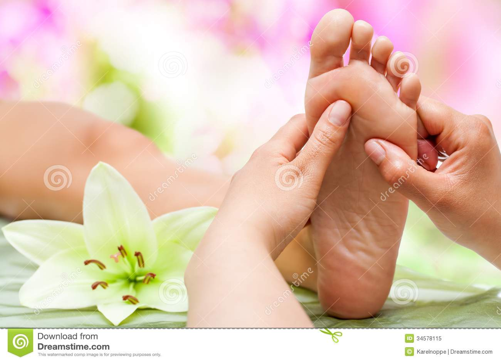Therapist hands massaging foot.