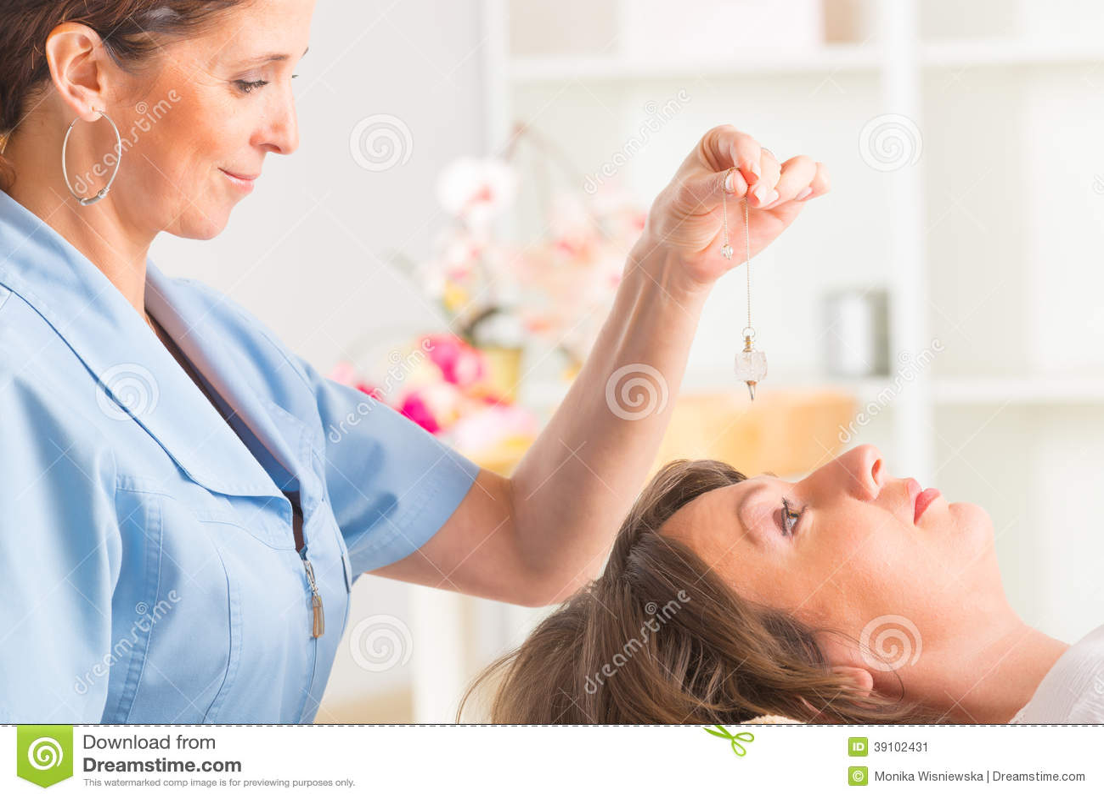 Therapist using pendulum