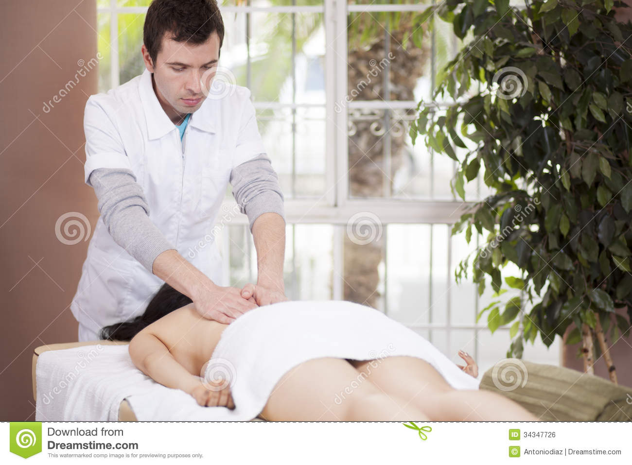 male massage therapist giving a man an happy ending
