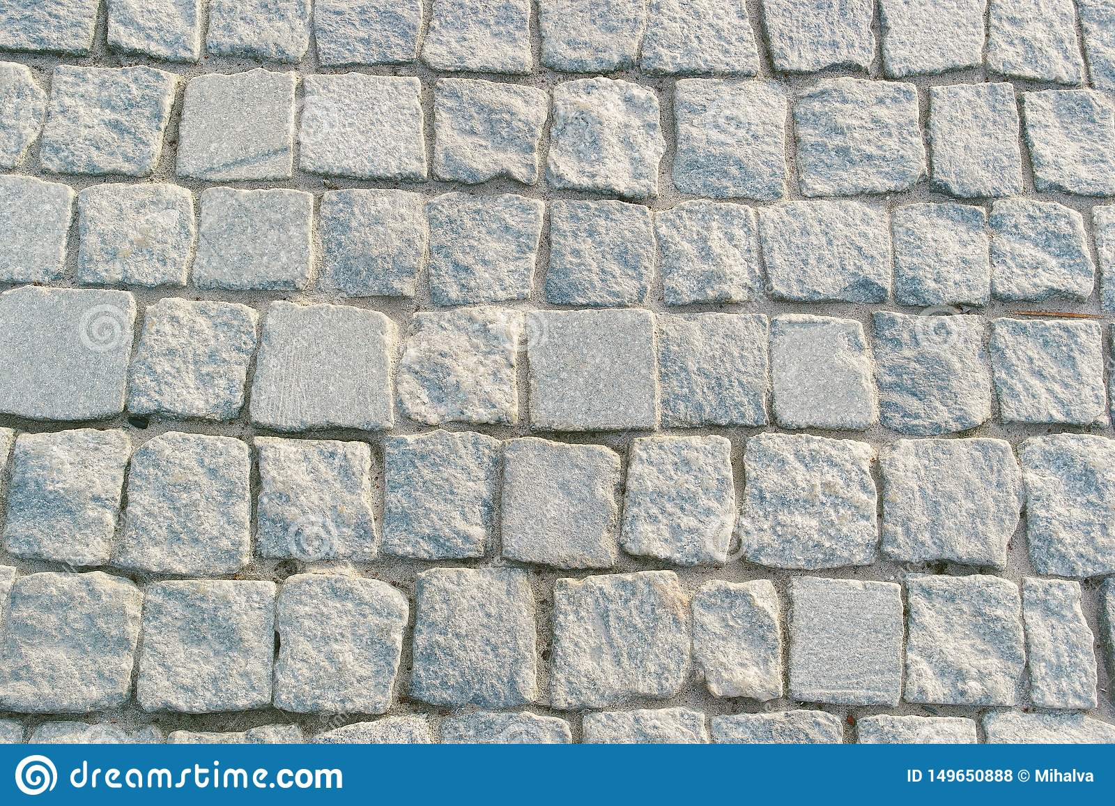 Gray paving stones on road