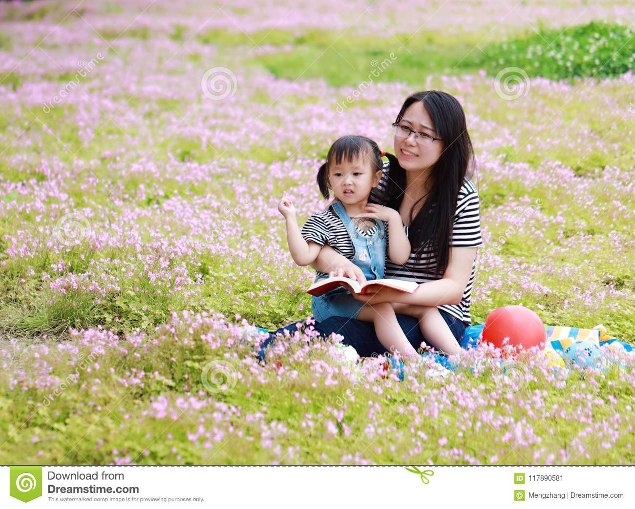 Happy Little Cute Baby Girl Smile And Laugh Read Book With