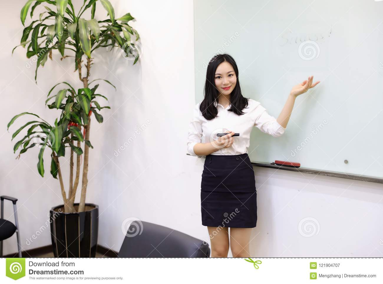 asia chinese office lady woman girl hand write success at whiteboard