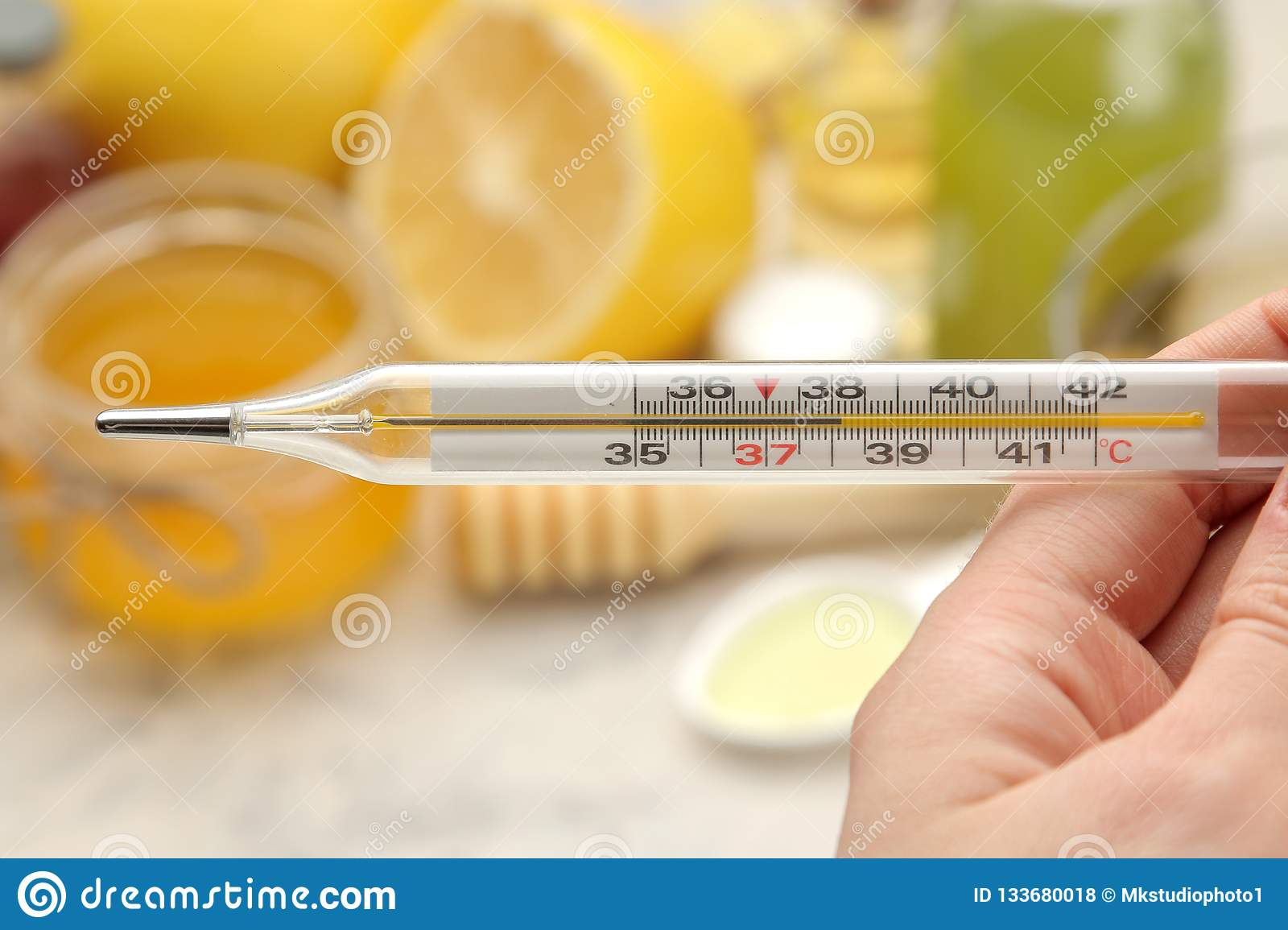 Thermometer Kru various medicines for flu and cold remedies on a white wooden table .. Cold. diseases. cold. flu