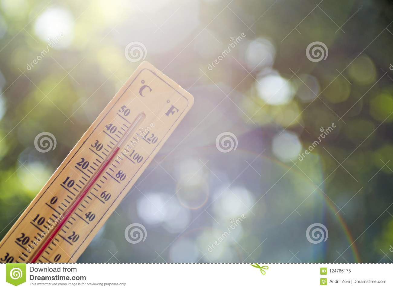 Thermometer pointing to the sky to symbolize the heat of summer