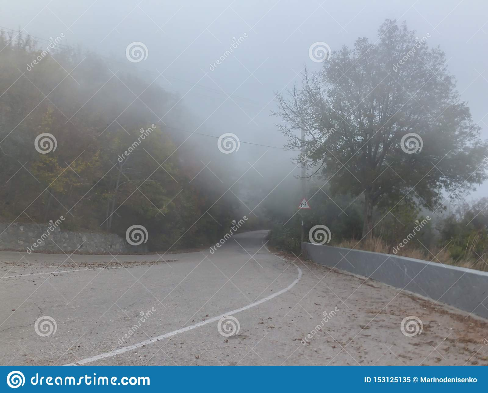 Thick fog covers old road Pass Baidar Gates in Crimean Mountains connecting Baydar Valley