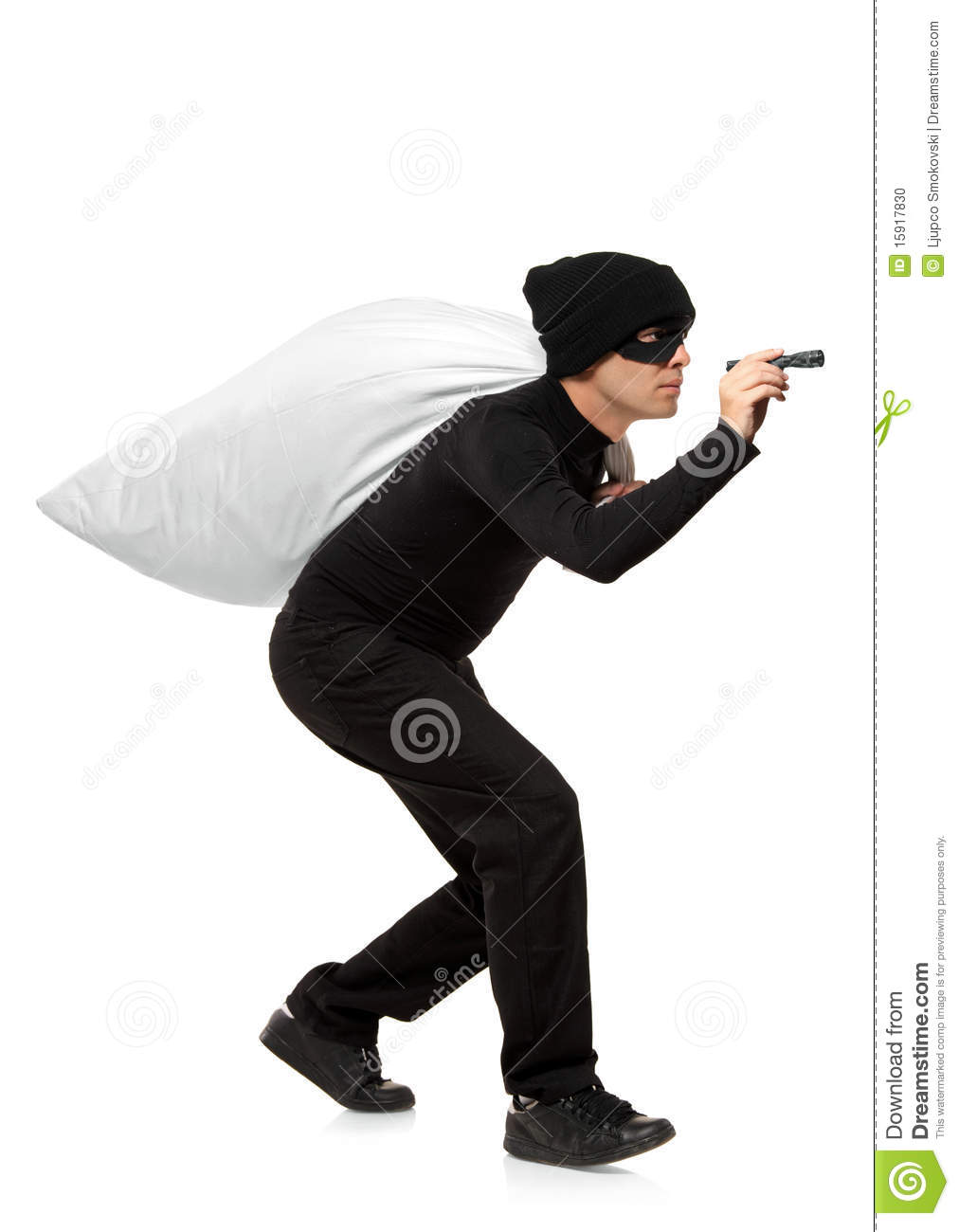 Thief Carrying A Bag And Holding A Torch Stock Photo - Image: 15917830