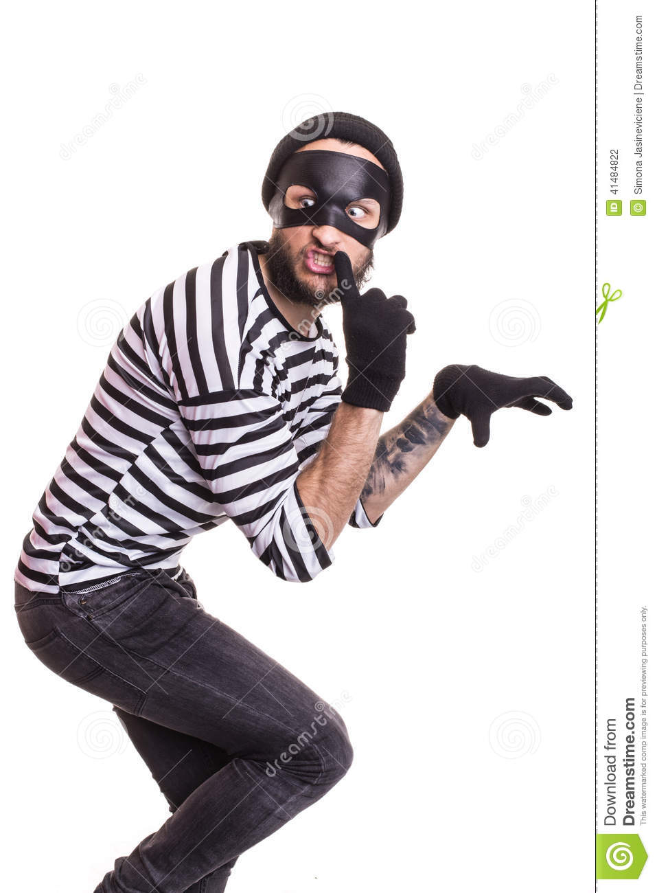 A Thief With Mask Quietly Slinking Stock Photo - Image ...