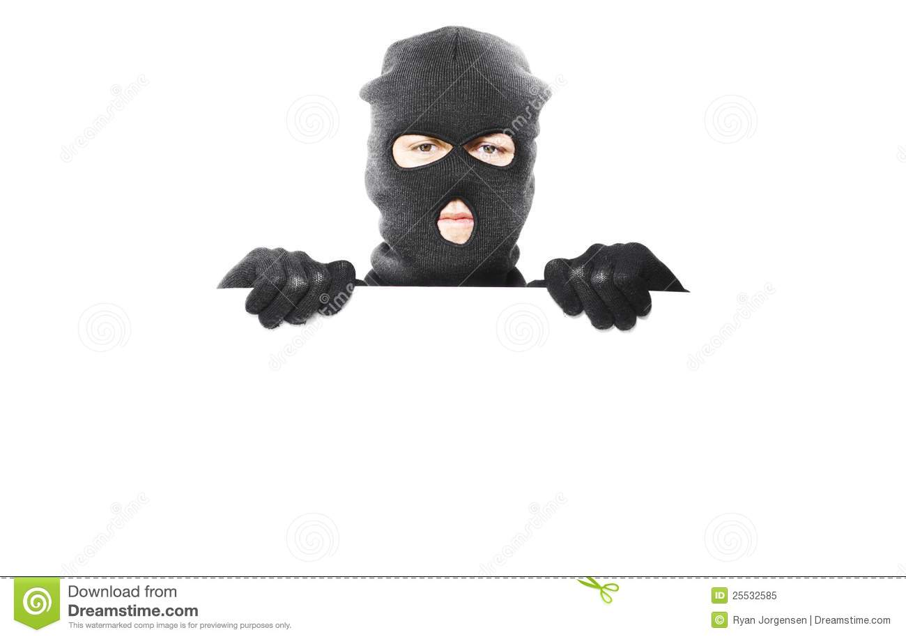 thief with robbery mask holding blank white board stock image