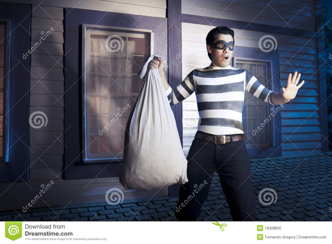 Thief On The Roof Of A House At Night Stock Photo Image