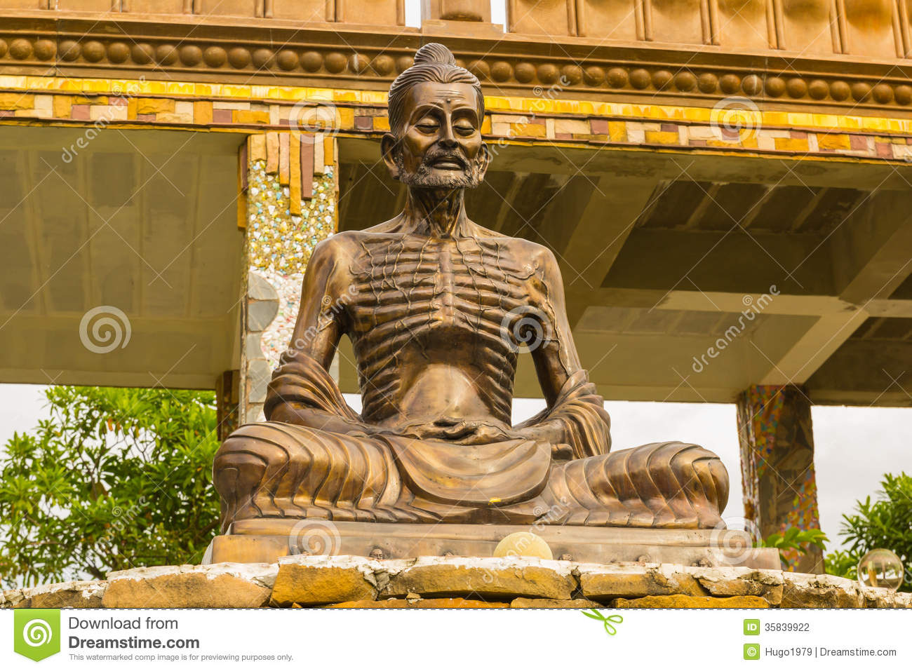 thin buddha statue in thailand temple stock photo