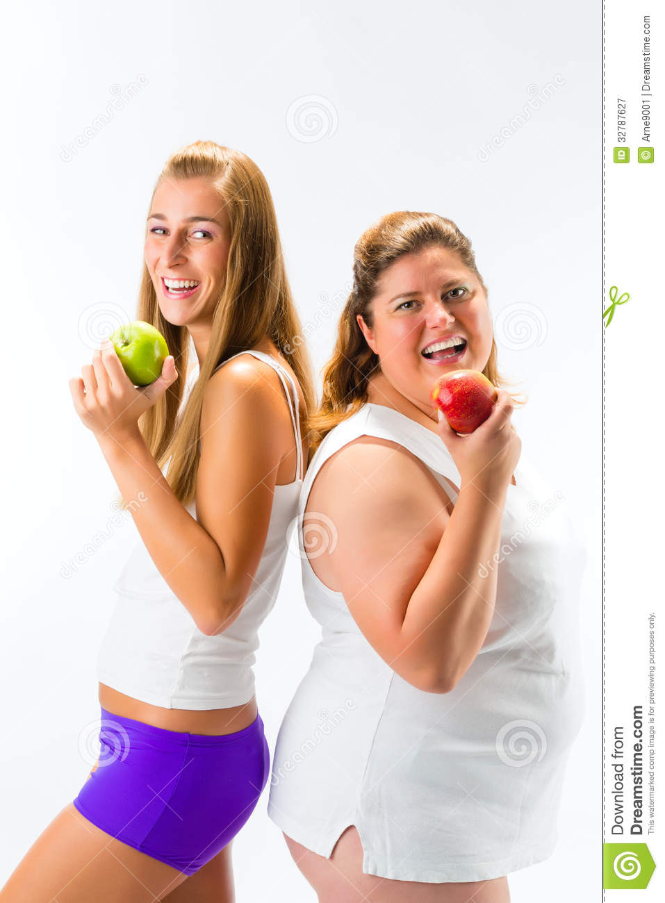 Thin and fat or obese women standing and holding an apple in hand ...