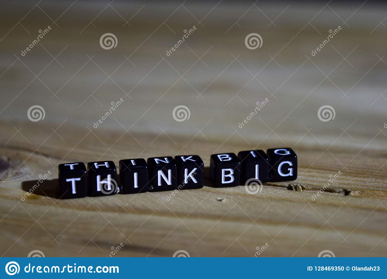 Think big on wooden blocks. Motivation and inspiration concept