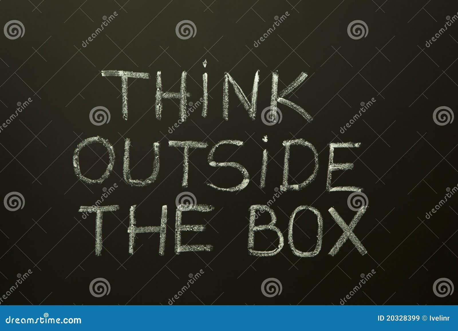 THINK OUTSIDE THE BOX on a blackboard