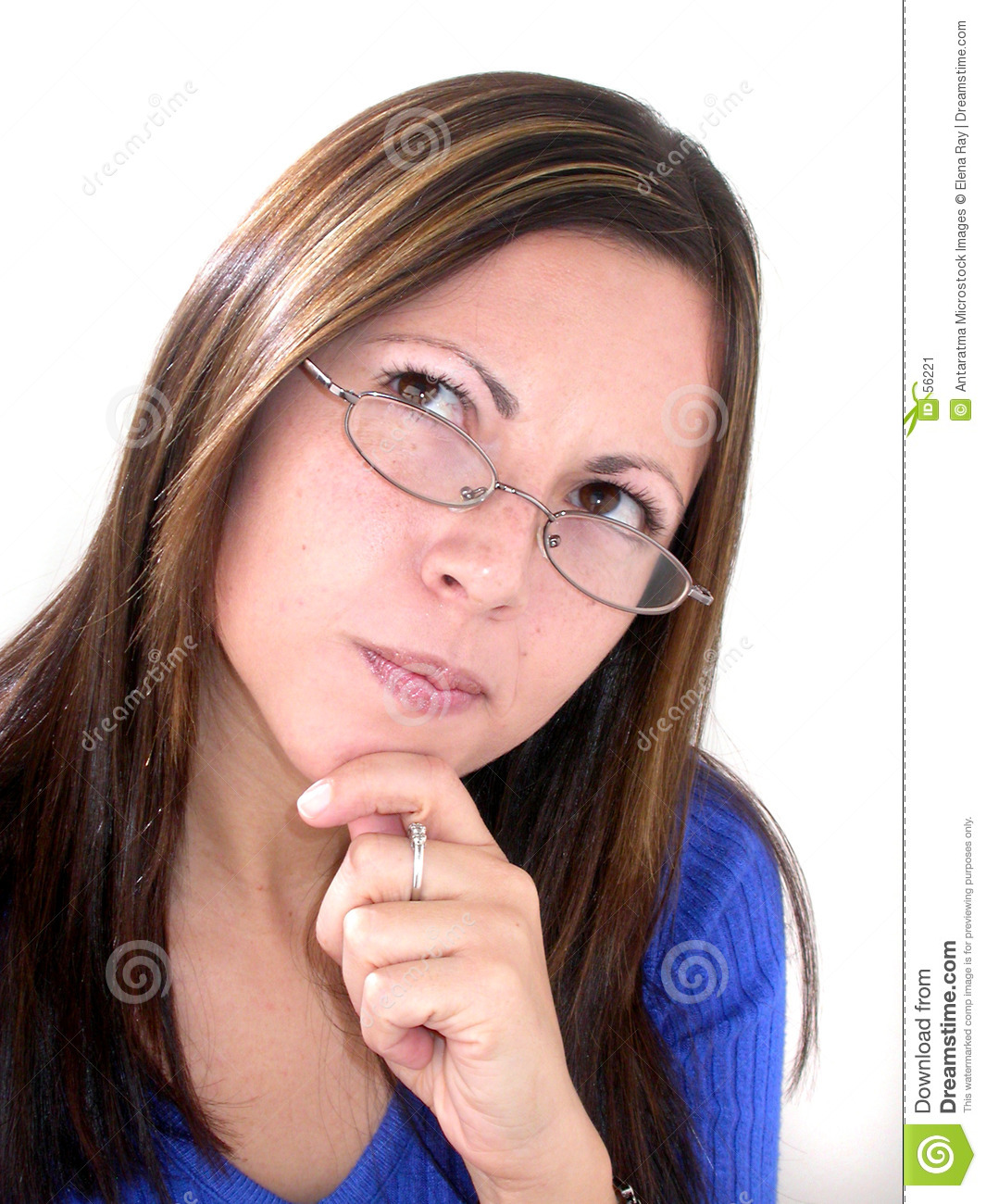 Young woman in glasses pondering, thinking,formulating