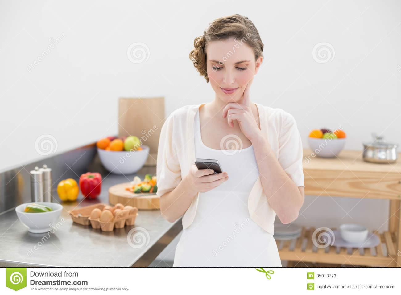 Thinking Beautiful Woman Using Her Smartphone Standing In The ...