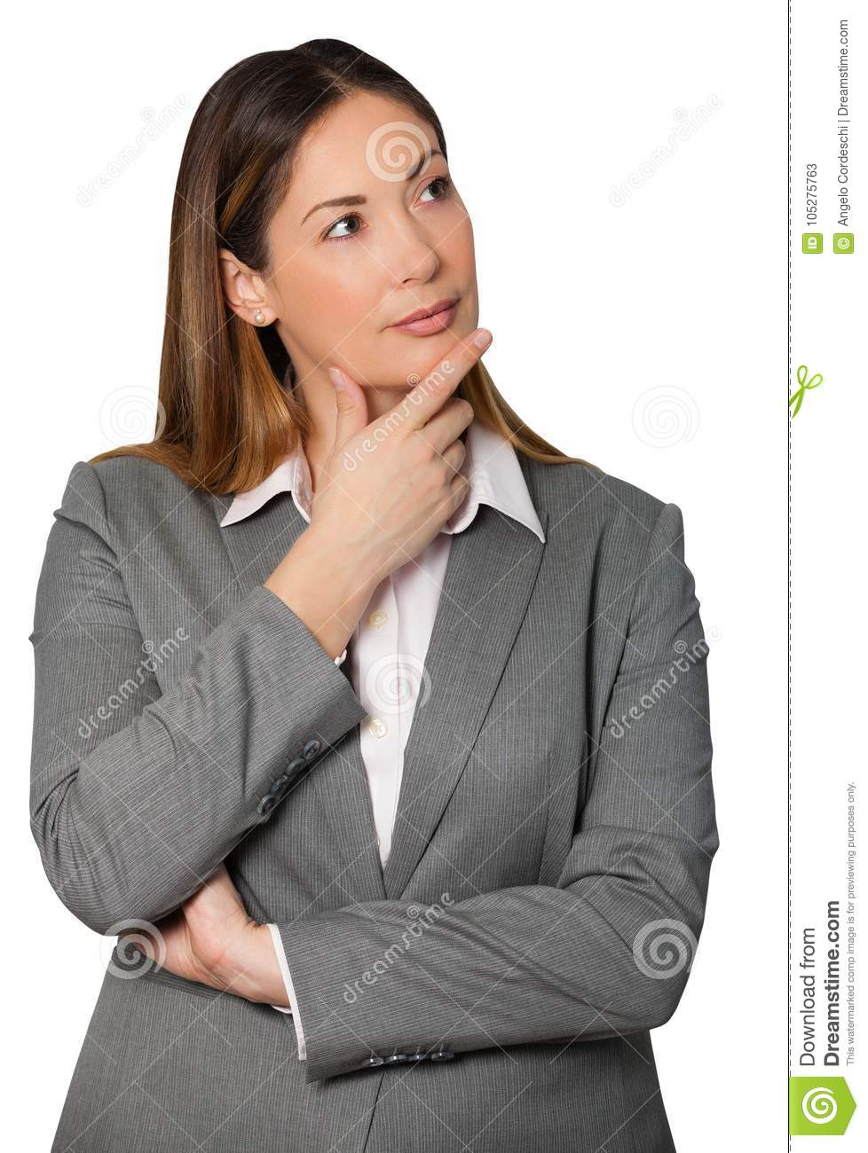 Thinking business woman holding hand under chin and arms folded