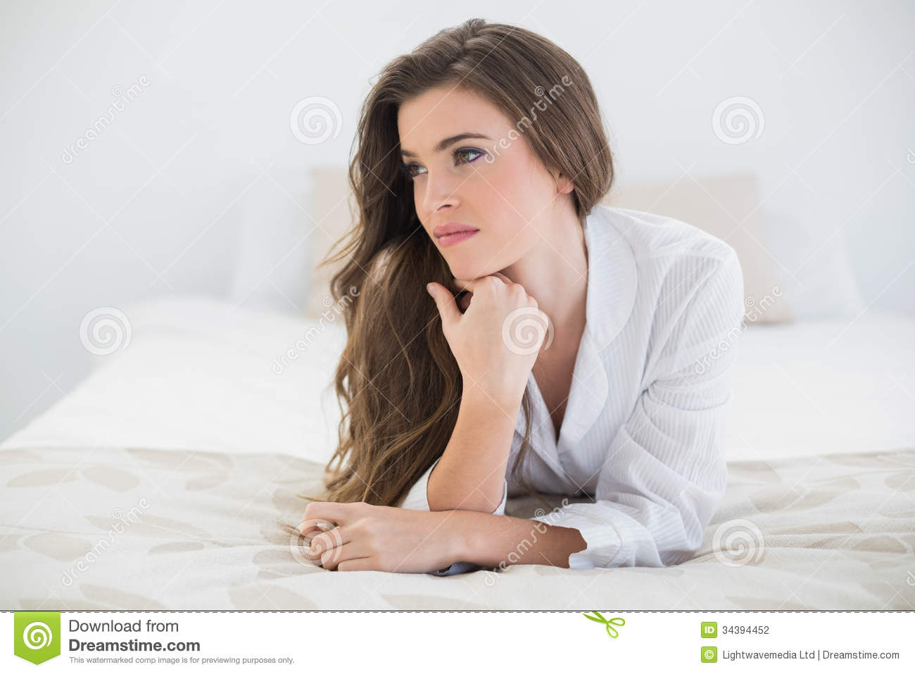 Homey App Thinking Casual Brown Haired Woman In White Pajamas Lying