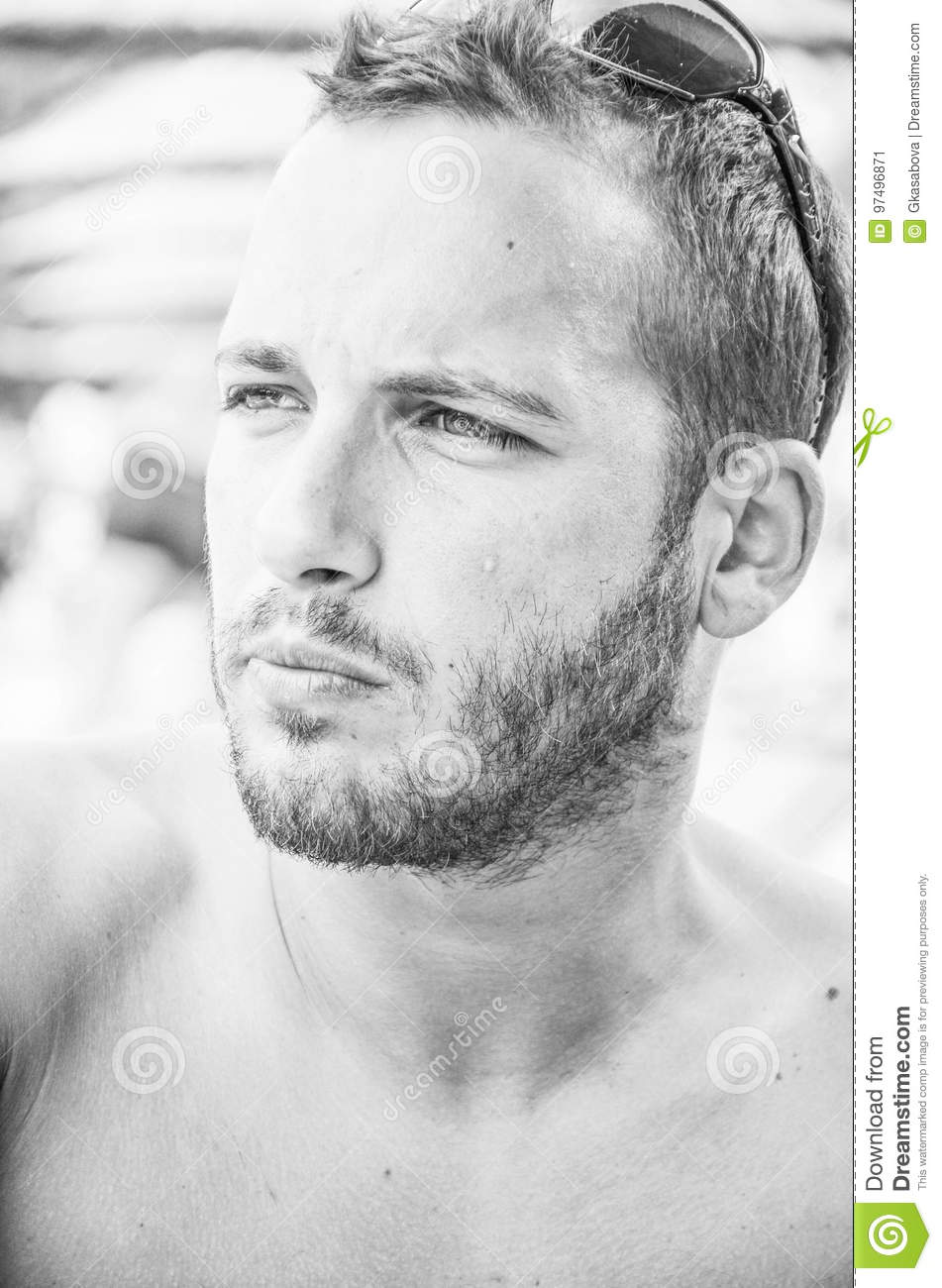 Black and white portrait of handsome seriuos bearded man