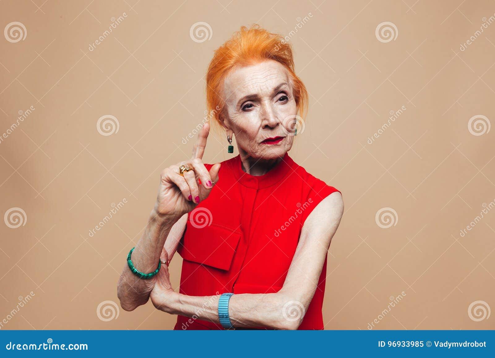 thinking mature redhead fashion woman stock image - image of face