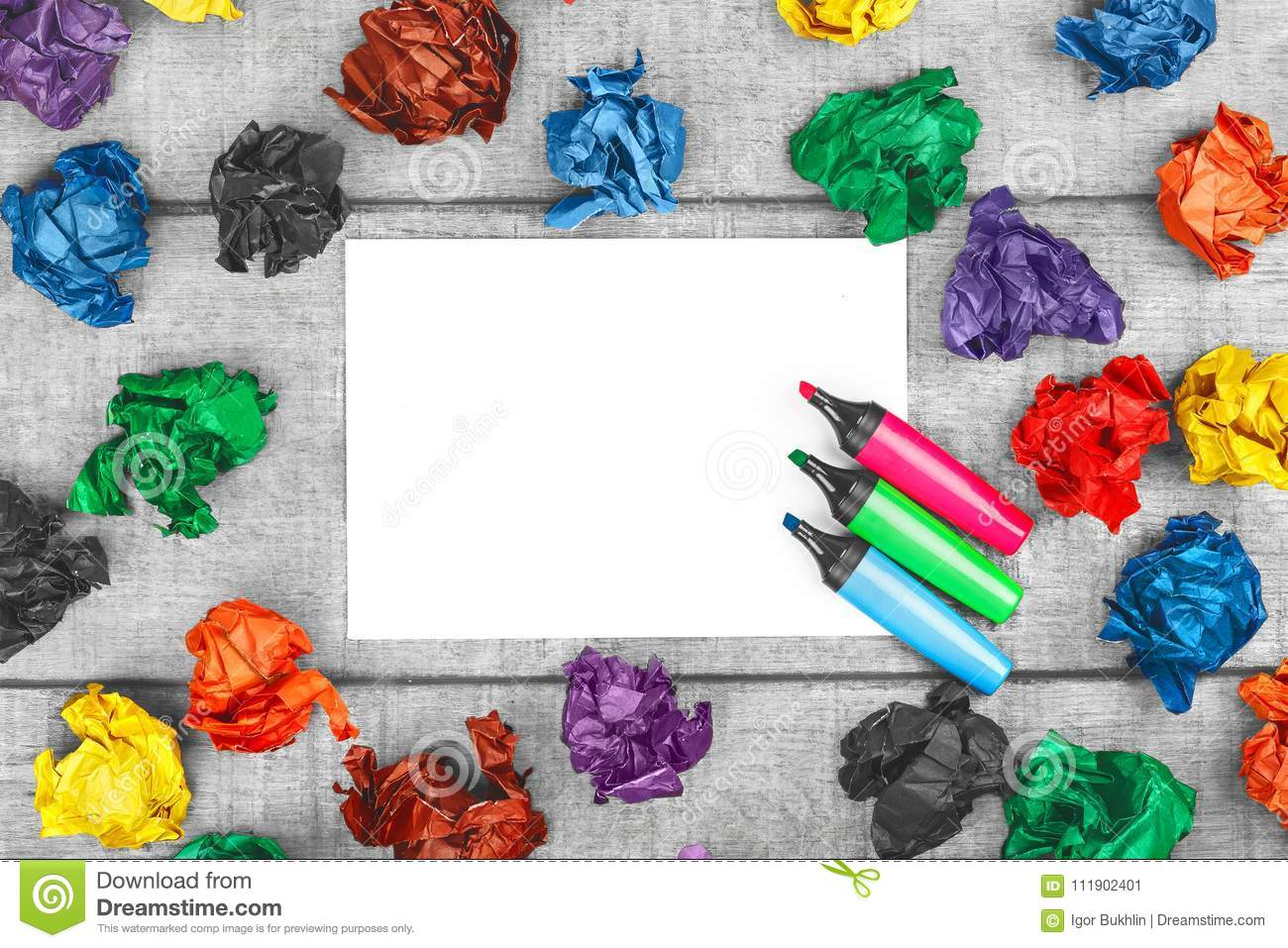 Thinking outside the box. Multicolored crumpled sheets of paper and blank sheet of paper with colorful felt pens.